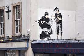 Sniper & Son – Banksy